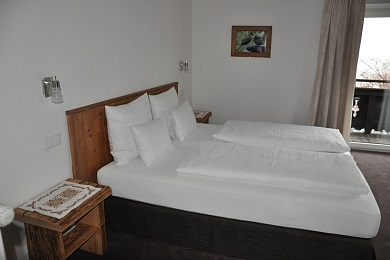 Wonderful bedroom 1 with couch, balcony and views to the town in holiday apartment 5, Elisabeth apartments